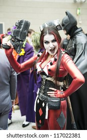 LONDON, UK - OCTOBER 28: Batman's Harley Quinn posing at the London Comicon MCM Expo. Most participants dress up as superheroes to compete in the Euro Cosplay Championship. October 28, 2012 in London.