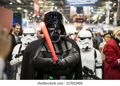 LONDON, UK - OCTOBER 28: Darth Vader and Storm Troopers pose at the London Comicon MCM Expo. Most participants dress up as superheroes for the Euro Cosplay Championship. October 28, 2012 in London.