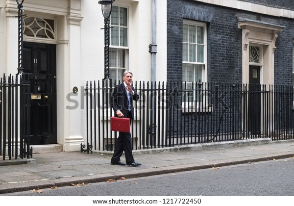 London, UK - October  29 2018: Chancellor Philip Hammond leaves No 11 Downing Street for the Houses of Parliament where he will deliver his  Budget.
