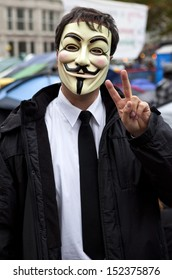 LONDON, UK - OCTOBER 30TH 2011: A masked protestor at the Occupy London camp outside St. Paul's Cathedral in London on 30th October 2011.