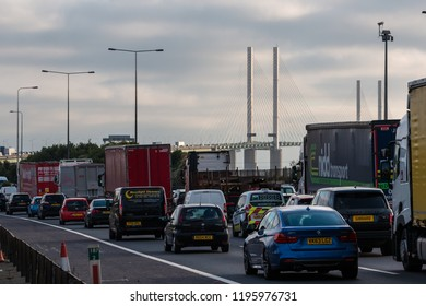 LONDON, UK - OCTOBER 4, 2018: Busy British motorway M25 at Dartford Crossing. Heavy traffic on Queen Elizabeth II bridge above Thames river