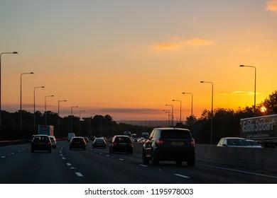 LONDON, UK - OCTOBER 4, 2018: Sunset above busy British motorway M25