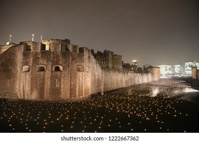 London, UK – October 5 2018: Lights fill the moat of the Tower of London as part of an art installation Beyond the Deepening Shadow, to mark the centenary of the end of the First World War