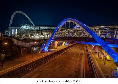 London, UK - October 6, 2016: The wembley stadium and wembley train station at night