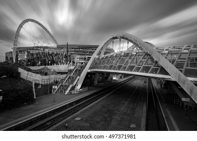 London, UK - October 6, 2016: The wembley stadium and wembley train station in black and white