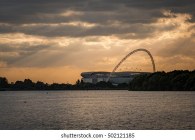 London, UK - October 6, 2016: The wembley stadium from across a body of water at sunset. Wembley is the English national stadium in London, England