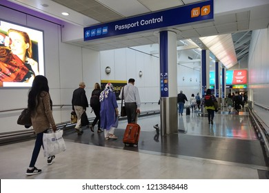 London, UK - October 6, 2018: Air travellers proceed to passport control at Heathrow airport. The immigration status of EU citizens remains unclear following Brexit.