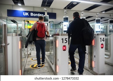 London, UK - October 6, 2018: Air travellers pass through automated passport border control gates at Heathrow Airport. The UK Border Force is on a recruitment drive in gearing up for Brexit.