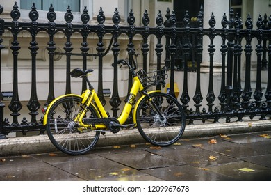 London, UK - October 6th, 2018 : OFO Bike sharing company by mobile app parked on street on London.