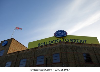 """London, UK - October 7, 2018: A giant """"bollocks to Brexit"""" sign on the roof of the Pimlico Plumbers HQ. The local council has ordered the boss, Charlie Mullins, to remove it or face prosecution."""