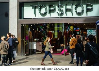 London, UK - October 7, 2018: People walk by Topshop store in Oxford Street, London, United Kingdom
