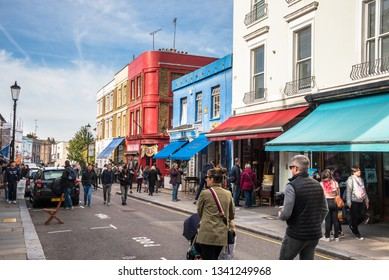 London, UK - October 7, 2018: View of Portobello Road Crowded with Tourists and Locals alike on a Sunday Afternoon. On Saturdays the Road is home to one of London's notable street market.