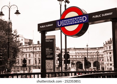 LONDON, UK - OCTOBER 9, 2014:  Iconic London Underground subway sign at Trafalgar Square.
