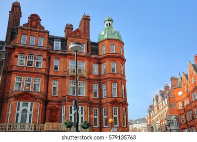 LONDON, UK: Red brick Victorian houses facades in Berkeley Square and Mount Street in the borough of Westminster