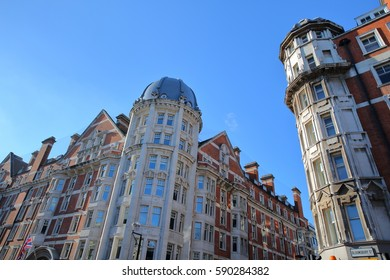 LONDON, UK: Red brick and white Victorian houses facades in Bloomsbury Street in the borough of Holborn