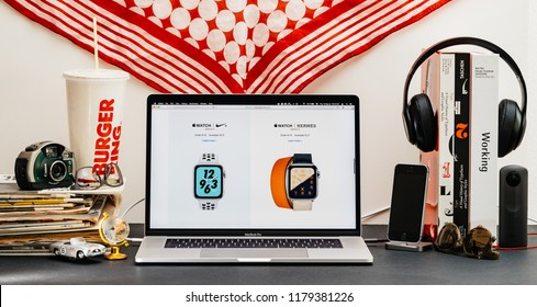 LONDON, UK - SEP 13, 2018: Creative room table with Safari Browser on MacBook Pro laptop showcasing Apple Computers website latest Apple Watch series 4 Nike and Hermes version of the watch