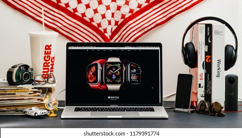 LONDON, UK - SEP 13, 2018: Creative room table with Safari Browser open on MacBook Pro laptop showcasing Apple Computers website latest Apple Watch Series 4,