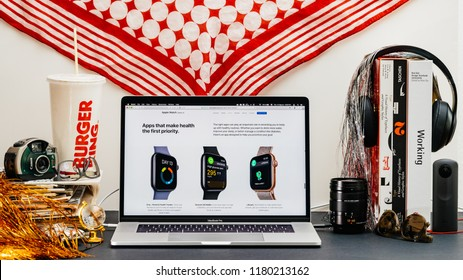 LONDON, UK - SEP 13, 2018: Creative room table with Safari Browser on MacBook Pro laptop showcasing Apple Computers website latest Apple Watch series 4 apps for health priority track