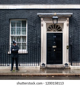 LONDON, UK - SEP 16: A  police officer guards the entrance door of 10 Downing Street in London on September 16, 2013