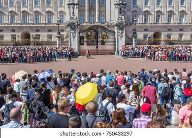 LONDON, UK - SEP 20, 2017: A large crowd gathered near Buckingham Palace in London, UK, to see traditional Changing of the Guards ceremony.