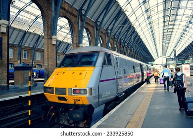 LONDON, UK - SEP 27: Kings Cross station with train on September 27, 2013 in London, UK. Opened in 1852, it is the southern terminus of the East Coast Main Line.