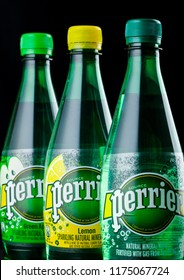 LONDON, UK - SEPTEMBER 03, 2018: Bottles of Perrier sparkling water on black background. Perrier is a French brand of natural bottled mineral water sold worldwide.