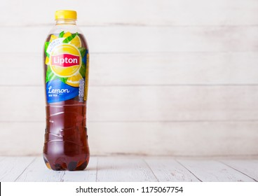 LONDON, UK - SEPTEMBER 03, 2018: Plastic bottle of Lipton Ice Tea with lemon flavour on wood.