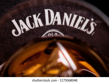 LONDON, UK - SEPTEMBER 04, 2018: Glass of Jack Daniel's whiskey with original coaster on wooden board.