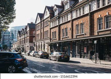 London, UK - September 07, 2019: Cars parked pon road near shops and cafes in Spitalfields Market, one of the finest surviving Market Halls in London with stalls offering fashion, antiques and food.