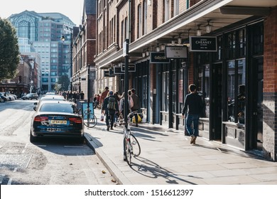 London, UK - September 07, 2019: People walking past the shops and cafes in Spitalfields Market, one of the finest surviving Market Halls in London with stalls offering fashion, antiques and food.