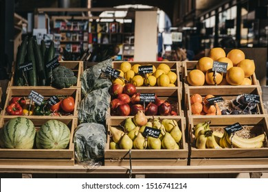 London, UK - September 07, 2019: Fresh fruits in wooden crates on sale at Spitalfields Market, one of the finest surviving Victorian Market Halls in London with fashion, antiques and food stalls.