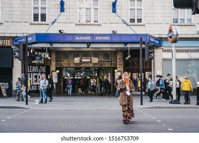 London, UK - September 07, 2019: People walking out of Aldgate, an Underground station in Aldgate area of Spitalfields named after nearby ward of Aldgate, motion blur, selective focus.