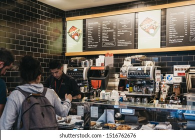 London, UK - September 07, 2019: Barista serving customers inside Pret a Manger, a popular international sandwich shop chain that is based in UK and has approximately 500 shops in nine countries.