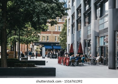 London, UK - September 07, 2019:People sitting at the outdoor tables of Costa Coffee in Spitalfields, London, UK. Costa Coffee is a British multinational coffeehouse company founded in London in 1971.