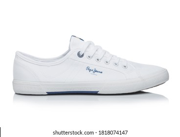 LONDON, UK - SEPTEMBER 09, 2020: Pepe Jeans white fabric sneakers on white background.