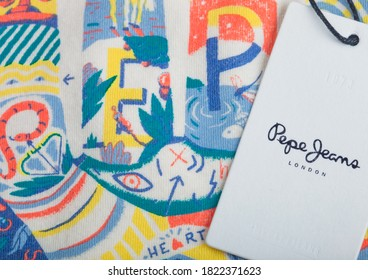 LONDON, UK - SEPTEMBER 09, 2020: Pepe Jeans clothing tag on cotton summer t-shirt.
