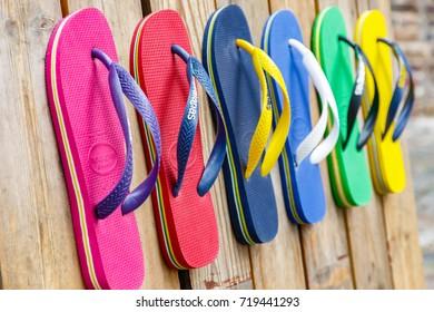 London, UK - September 1, 2017 - Flip flops in various colours on display at Camden Town