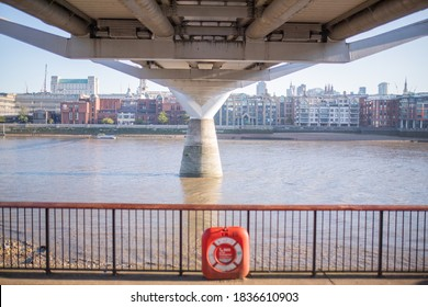 London, UK / September 1, 2020 -Landscape View of Orange Emergency Floatation Device Along the Thames Path in the UK