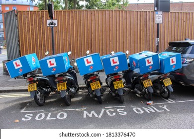 London / UK - September 11 2020: Row of Domino's Pizza Delivery Bikes, Wandsworth, London