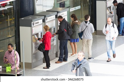 LONDON, UK - SEPTEMBER 12, 2015: People purchasing train tickets from machine. Liverpool street train station with lots of people