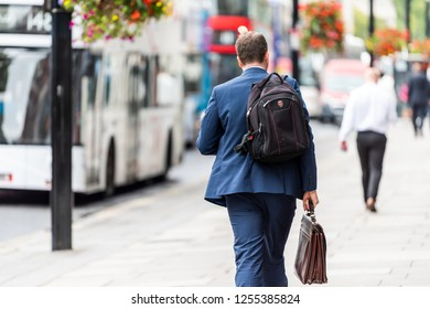 London, UK - September 12, 2018: Neighborhood district of Pimlico Street, businessman man walking with briefcase and backpack before or after work