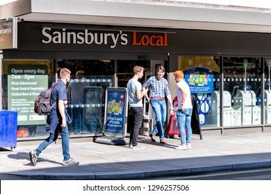 London, UK - September 12, 2018: Neighborhood store Sainsbury's local sign grocery shopping storefront facade exterior entrance with people in Westminster