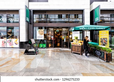 London, UK - September 12, 2018: Whole Foods Market Wholefoods store shop entrance on Glasshouse street with rainy wet day in Soho