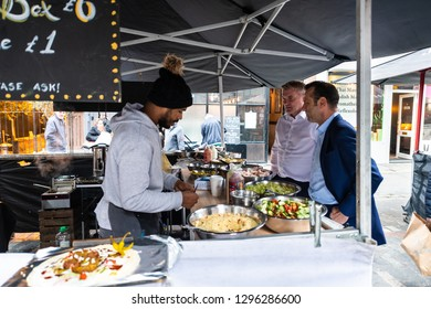 London, UK - September 12, 2018: Famous Brewer Market Street with Soho food stall and vendor outside and people ordering fresh
