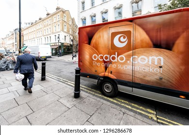 London, UK - September 12, 2018: Ocado online store grocery shopping delivery supermarket sign on truck with red orange color in Covent Garden near SoHo