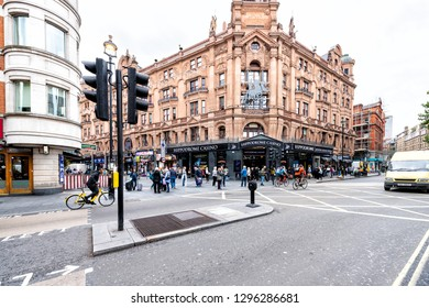 London, UK - September 12, 2018: Street road in Covent Garden near Leicester Square with many tourists people and cars in traffic with Hippodrome Casino