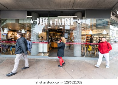 London, UK - September 12, 2018: Neighborhood of Pimlico Victoria with people walking on sidewalk by Pret A Manger modern cafe restaurant sign entrance