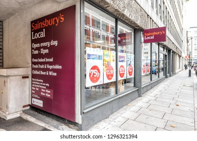 London, UK - September 12, 2018: Neighborhood community store Sainsbury's local sign grocery shopping storefront facade exterior entrance with nobody in Westminster