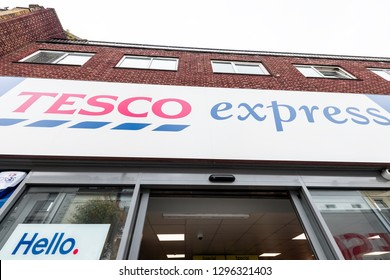 London, UK - September 12, 2018: Neighborhood local store Tesco Express blue grocery shopping storefront facade exterior entrance with sign closeup in Pimlico