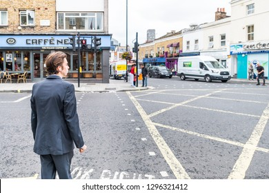 London, UK - September 12, 2018: Neighborhood of Pimlico with road and cafe Nero restaurant and one business man people waiting to cross street